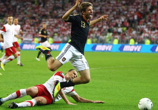 Poland 2-2 Germany: Joachim Low's men battle to draw 10-man hosts in injury time