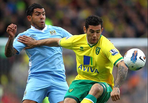 Norwich City 1-6 Manchester City: Tevez hat-trick & Aguero double fires visitors to within two points of United in title race