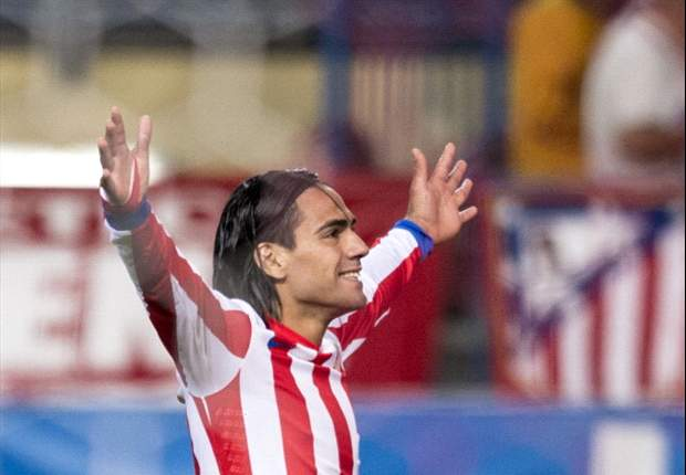 Atletico Madrid 2-1 Malaga: Weligton own goal moves capital club level with Barcelona in La Liga