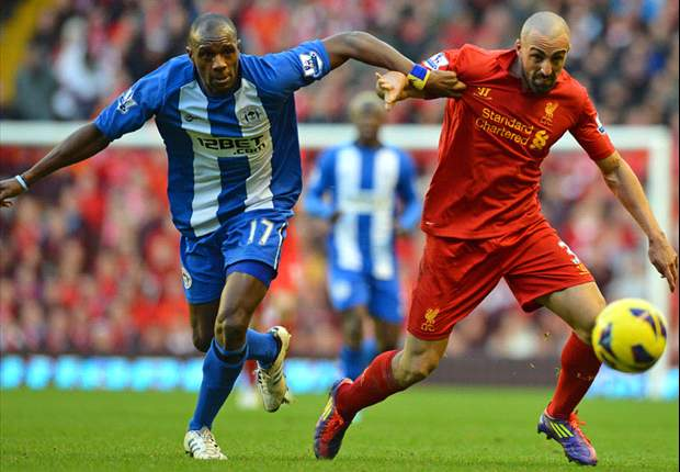 Liverpool 3-0 Wigan: Sensational Suarez seals comfortable Reds win