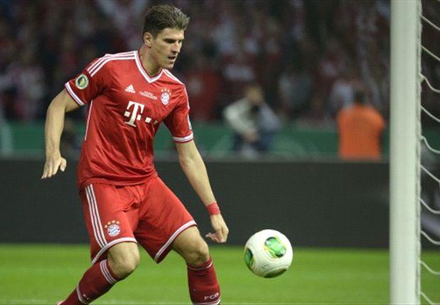 Bayern Munich 3-2 Stuttgart: Gomez at the double as Bavarians survive Schwaben fightback to complete treble