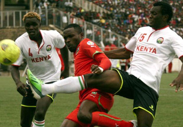 Kenya defenders David Owino and David Ochieng battles a Malawi opponent
