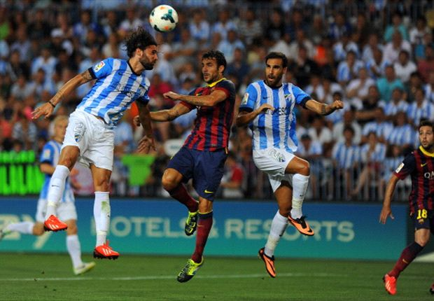 Malaga 0-1 Barcelona: Adriano gives lacklustre Blaugrana narrow win